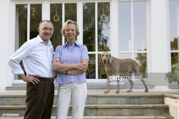Sonnleitner Gerd President of the German Farmer's Association Germany with his wife Rita and the dog Enno at his farm in Bavaria