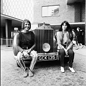 Sonny and Cher pose on the front of a Rolls Royce car outside BBC TV Centre before an appearance on Top Of The Pops London 1965