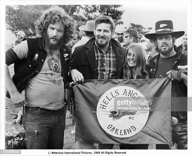 Sonny Barger and the Hell's Angels holding their flag in a scene from the film 'Hell's Angels '69' 1969
