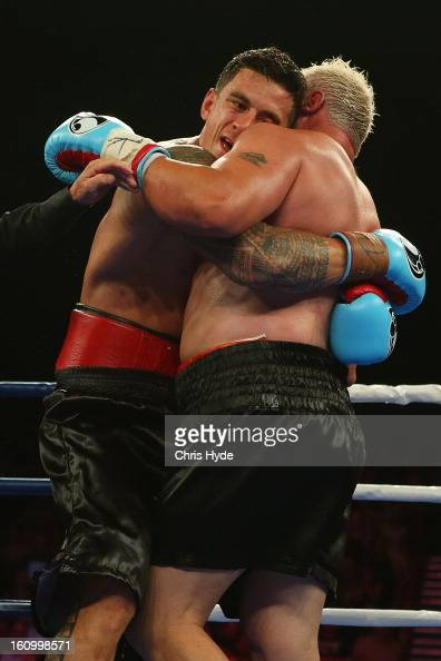 Sonny Bill Williams and Francois Botha clinch during their heavyweight bout at the Brisbane Entertainment Centre on February 8 2013 in Brisbane...