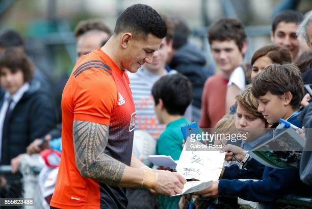 Sonny Bill Williams of All Blacks signs autographs during the New Zealand Rugby Championship Captain's Run ahead of the match against Argentina at...