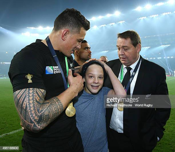 Sonny Bill Williams of New Zealand gives his winners medal to a young fan following the 2015 Rugby World Cup Final match between New Zealand and...