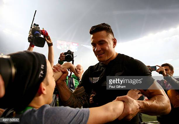 Sonny Bill Williams of New Zealand gives his winning medal to young fan Charlie Lines after the 2015 Rugby World Cup Final match between New Zealand...
