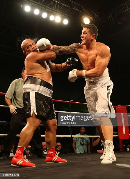 Sonny Bill Williams of New Zealand punches Alipate Liava'a during the Clash for Canterbury Fight Night at Trusts Stadium on June 5 2011 in Auckland...