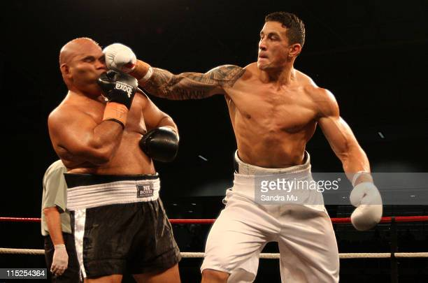 Sonny Bill Williams of New Zealand punches Alipate Liava'a of Tonga during the Clash for Canterbury Fight Night at Trusts Stadium on June 5 2011 in...