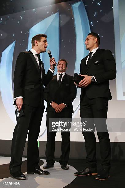 Sonny Bill Williams of New Zealand receives a replacement winners medal for the one that he gave to young fan Charlie Lines during the World Rugby...