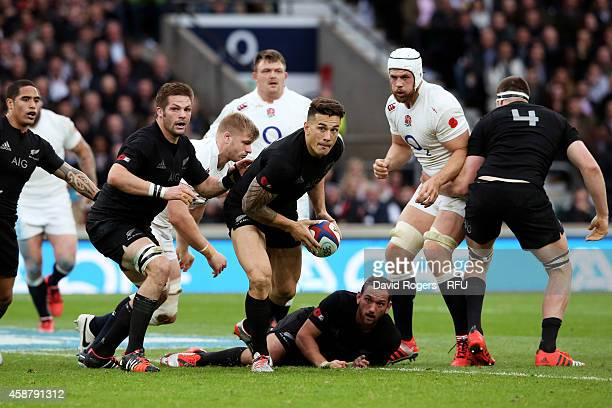 Sonny Bill Williams of New Zealand runs with the ball during the QBE International match between England and New Zealand at Twickenham Stadium on...