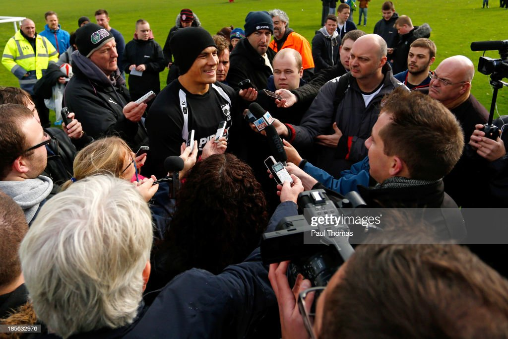<a gi-track='captionPersonalityLinkClicked' href=/galleries/search?phrase=Sonny+Bill+Williams&family=editorial&specificpeople=204424 ng-click='$event.stopPropagation()'>Sonny Bill Williams</a> of New Zealand smiles during an interview after the New Zealand training session at St Helens Rugby League Cowley training complex on October 23, 2013 in St Helens, England.