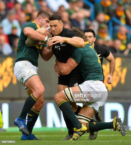 Sonny Bill Williams of New Zealand tackled by Malcolm Marx of South Africa and Lood de Jager of South Africa during the Rugby Championship 2017 match...