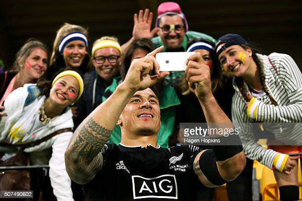 Sonny Bill Williams of New Zealand takes a selfie with fans during the 2016 Wellington Sevens at Westpac Stadium on January 30 2016 in Wellington New...