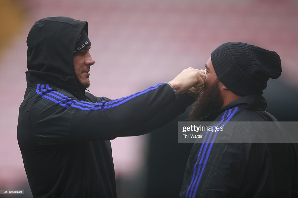 Sonny Bill Williams of the All Blacks (L) adjusts the beard of Charlie Faumuina (R) during a New Zealand All Blacks training session at Mowden Park on October 5, 2015 in Darlington, United Kingdom.
