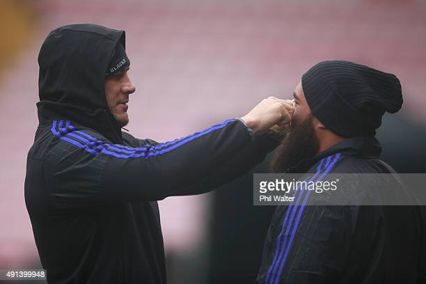 Sonny Bill Williams of the All Blacks adjusts the beard of Charlie Faumuina during a New Zealand All Blacks training session at Mowden Park on...