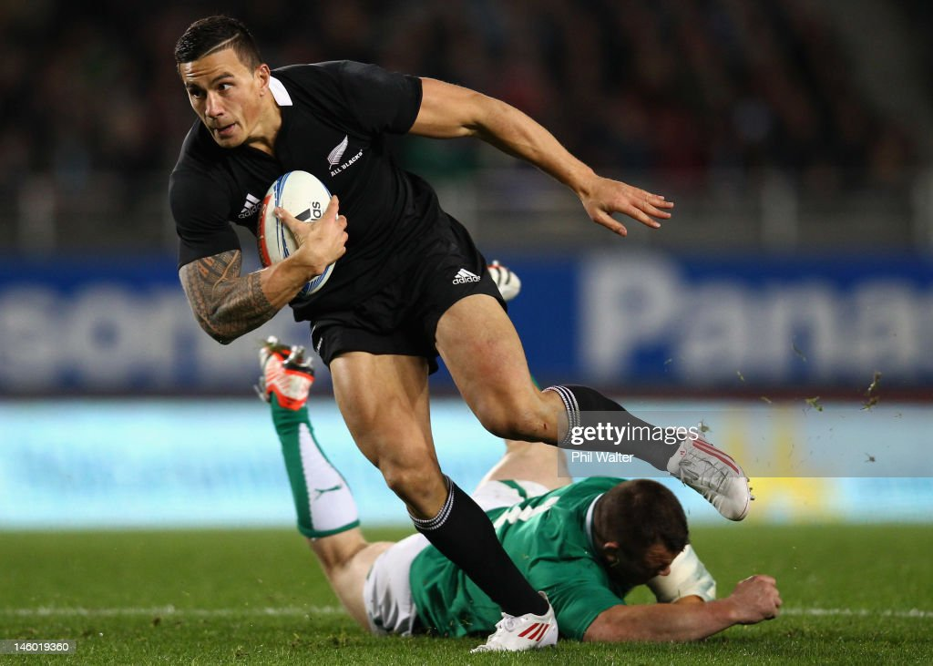 <a gi-track='captionPersonalityLinkClicked' href=/galleries/search?phrase=Sonny+Bill+Williams&family=editorial&specificpeople=204424 ng-click='$event.stopPropagation()'>Sonny Bill Williams</a> of the All Blacks breaks through the tackle of <a gi-track='captionPersonalityLinkClicked' href=/galleries/search?phrase=Cian+Healy&family=editorial&specificpeople=4166531 ng-click='$event.stopPropagation()'>Cian Healy</a> of Ireland during the International Test Match between the New Zealand All Blacks and Ireland at Eden Park on June 9, 2012 in Auckland, New Zealand.