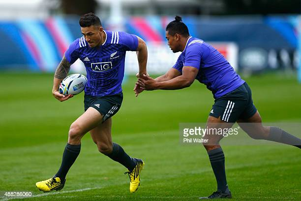 Sonny Bill Williams of the All Blacks runs past Julian Savea during a New Zealand All Blacks training session at Lensbury on September 15 2015 in...