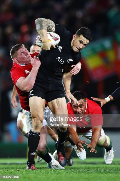 Sonny Bill Williams of the All Blacks shrugs off the tackles from Tadhg Furlong and Mako Vunipola of the Lions during the first test match between...