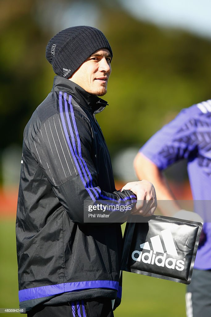 Sonny Bill Williams of the All Blacks watches training from the sideline during a New Zealand All Blacks training session at Trusts Stadium on August 11, 2015 in Auckland, New Zealand.