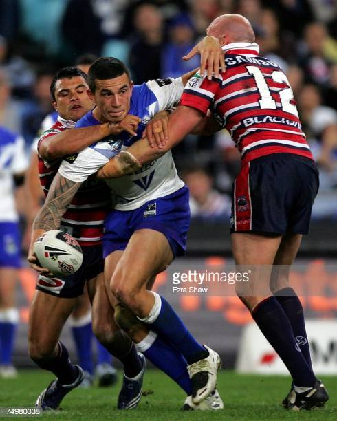 Sonny Bill Williams of the Bulldogs looks to pass while being tackled by Craig Wing and Craig Fitzgibbon of the Roosters during the round 16 NRL...