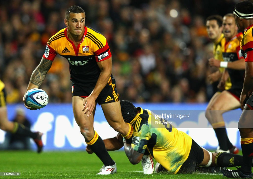 Sonny Bill Williams of the Chiefs is tackled by Victor Vito of the Hurricanes during the round 10 Super Rugby match between the Chiefs and the...