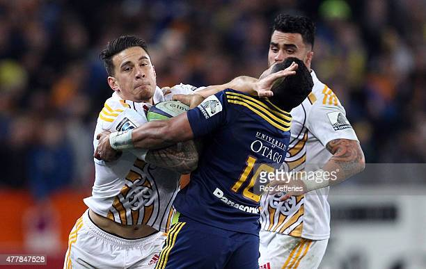 Sonny Bill Williams of the Chiefs looks to bust the tackle of Lima Sopoaga of the Highlanders during the Super Rugby Qualifying Final match between...