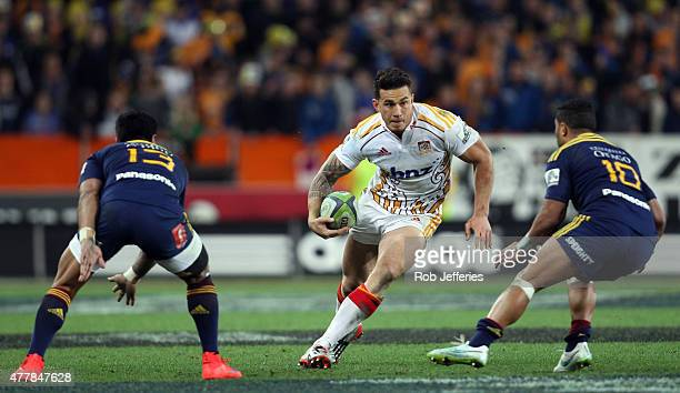 Sonny Bill Williams of the Chiefs looks to bust the tackle of Lima Sopoaga and Malakai Fekitoa of the Highlanders during the Super Rugby Qualifying...