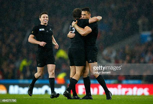 Sonny Bill Williams of the New Zealand All Blacks is embraced by Conrad Smith of the New Zealand All Blacks at the end of the match as Beauden...