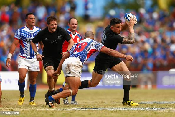 Sonny Bill Williams of the New Zealand All Blacks is tackled by Paul Perez of Manu Samoa during the International Test match between Samoa and the...