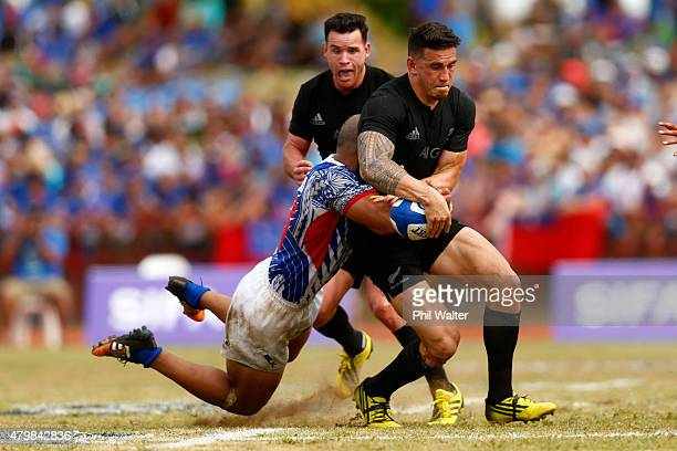 Sonny Bill Williams of the New Zealand All Blacks is tackled during the International Test match between Samoa and the New Zealand All Blacks at Apia...