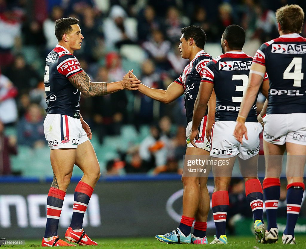 Sonny Bill Williams (C) of the Roosters celebrates with team mates after scoring a try during the round 23 NRL match between the Wests Tigers and the Sydney Roosters at Allianz Stadium on August 19, 2013 in Sydney, Australia.