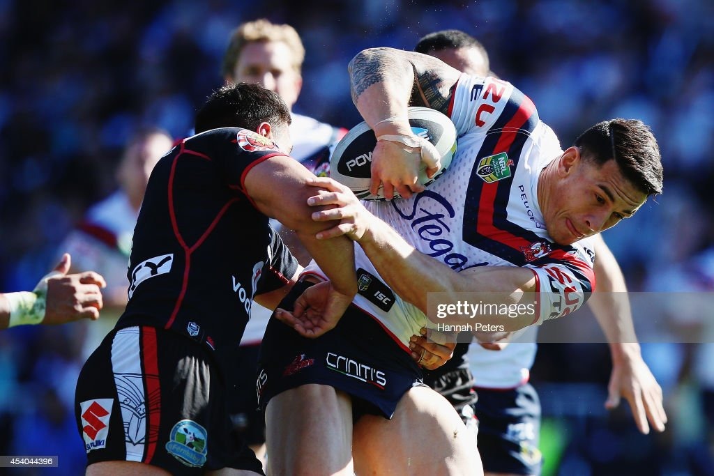 Sonny Bill Williams of the Roosters charges forward during the round 24 NRL match between the New Zealand Warriors and the Sydney Roosters at Mt Smart Stadium on August 24, 2014 in Auckland, New Zealand.