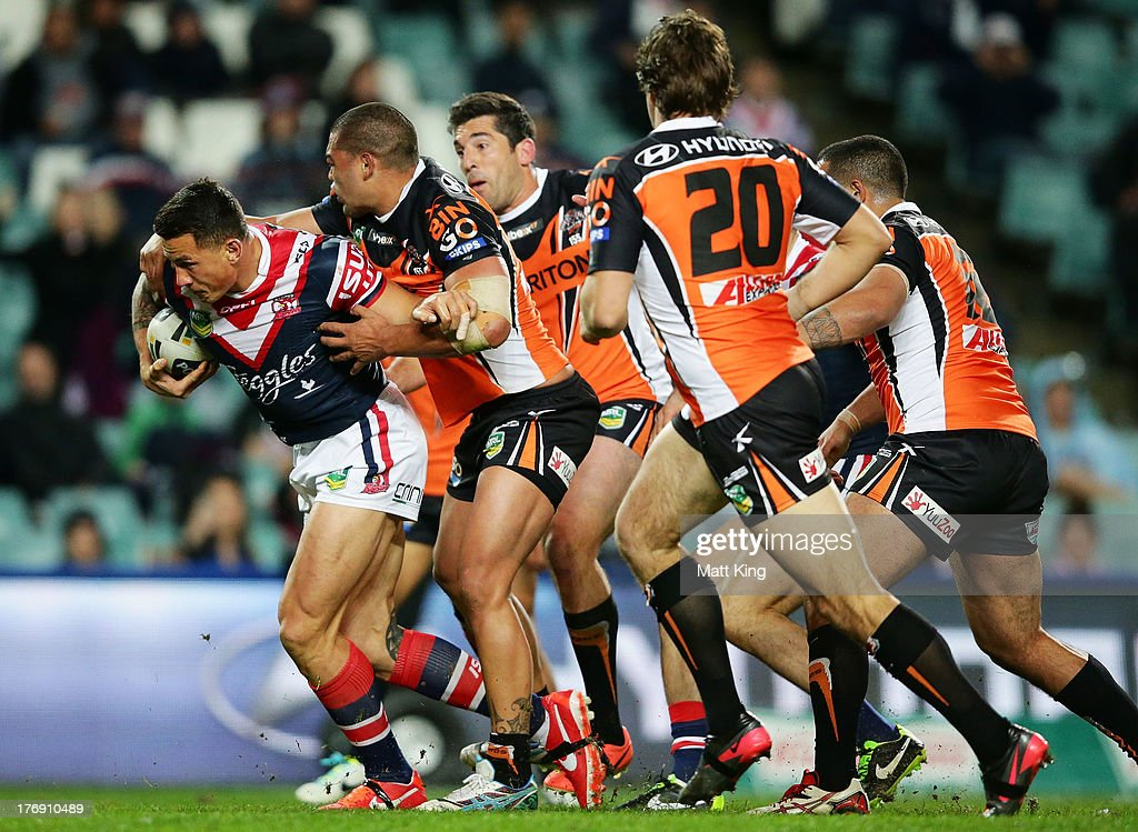 Sonny Bill Williams of the Roosters charges towards the line to score a try during the round 23 NRL match between the Wests Tigers and the Sydney Roosters at Allianz Stadium on August 19, 2013 in Sydney, Australia.