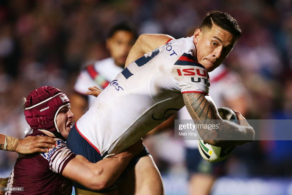 <a gi-track='captionPersonalityLinkClicked' href=/galleries/search?phrase=Sonny+Bill+Williams&family=editorial&specificpeople=204424 ng-click='$event.stopPropagation()'>Sonny Bill Williams</a> of the Roosters is tackled during the round 16 NRL match between the Manly Warringah Sea Eagles and the Sydney Roosters at Brookvale Oval on June 27, 2014 in Sydney, Australia.