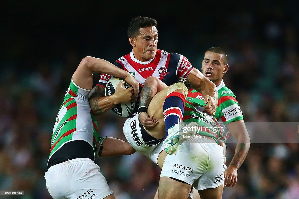 <a gi-track='captionPersonalityLinkClicked' href=/galleries/search?phrase=Sonny+Bill+Williams&family=editorial&specificpeople=204424 ng-click='$event.stopPropagation()'>Sonny Bill Williams</a> of the Roosters is tackled during the round one NRL match between the Sydney Roosters and the South Sydney Rabbitohs at Allianz Stadium on March 7, 2013 in Sydney, Australia.