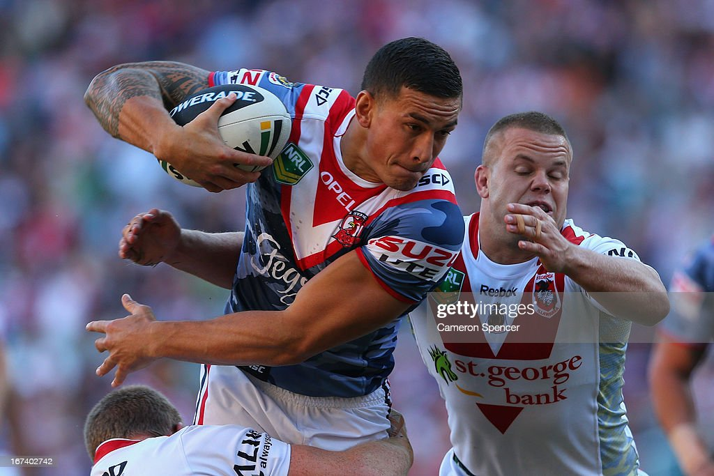 <a gi-track='captionPersonalityLinkClicked' href=/galleries/search?phrase=Sonny+Bill+Williams&family=editorial&specificpeople=204424 ng-click='$event.stopPropagation()'>Sonny Bill Williams</a> of the Roosters is tackled during the round seven NRL match between the Sydney Roosters and the St George Illawarra Dragons at Allianz Stadium on April 25, 2013 in Sydney, Australia.