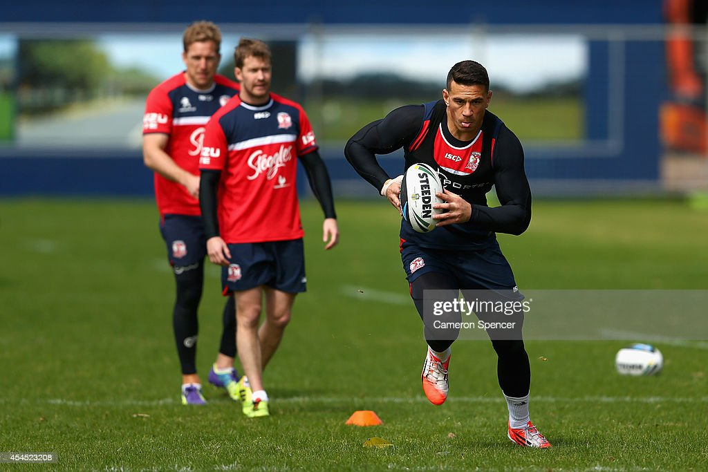 <a gi-track='captionPersonalityLinkClicked' href=/galleries/search?phrase=Sonny+Bill+Williams&family=editorial&specificpeople=204424 ng-click='$event.stopPropagation()'>Sonny Bill Williams</a> of the Roosters runs the ball during a Sydney Roosters NRL training session at Kippax Lake on September 3, 2014 in Sydney, Australia.