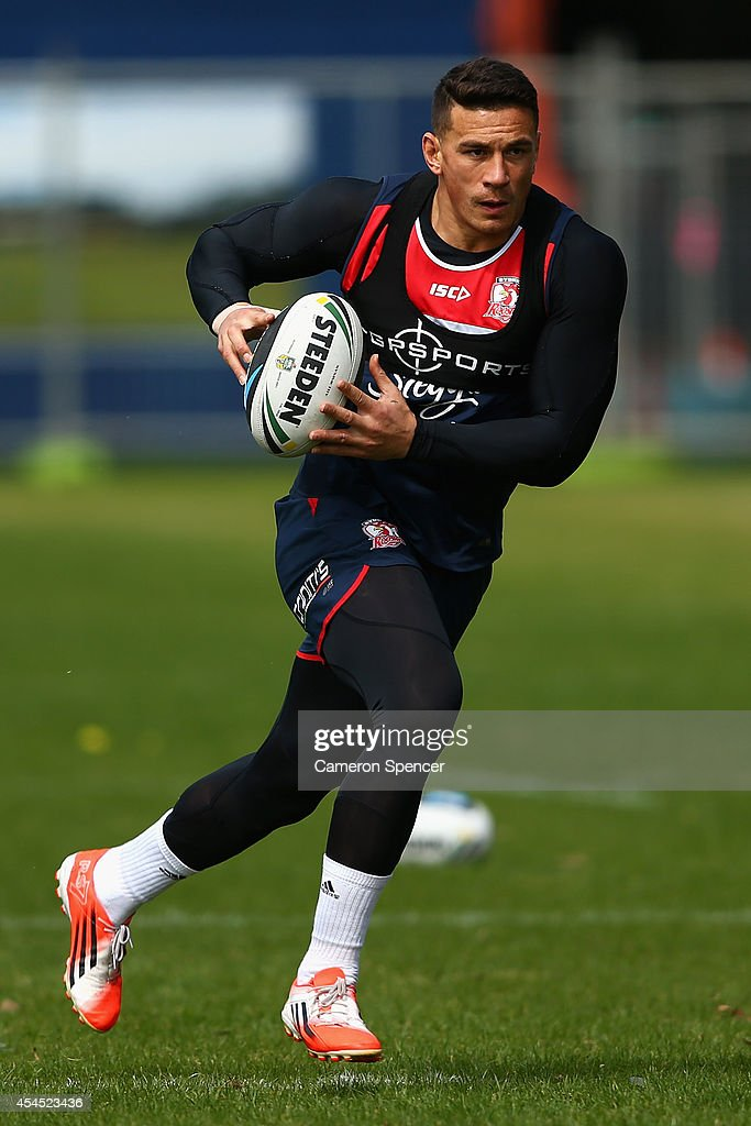 Sonny Bill Williams of the Roosters runs the ball during a Sydney Roosters NRL training session at Kippax Lake on September 3, 2014 in Sydney, Australia.