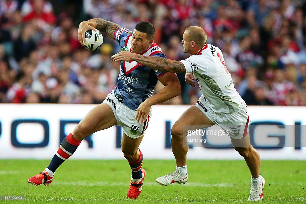 <a gi-track='captionPersonalityLinkClicked' href=/galleries/search?phrase=Sonny+Bill+Williams&family=editorial&specificpeople=204424 ng-click='$event.stopPropagation()'>Sonny Bill Williams</a> of the Roosters tries to pass <a gi-track='captionPersonalityLinkClicked' href=/galleries/search?phrase=Matt+Cooper+-+Rugby+Player&family=editorial&specificpeople=210629 ng-click='$event.stopPropagation()'>Matt Cooper</a> of the Dragons during the round seven NRL match between the Sydney Roosters and the St George Illawarra Dragons at Allianz Stadium on April 25, 2013 in Sydney, Australia.