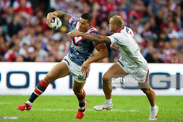 Sonny Bill Williams of the Roosters tries to pass Matt Cooper of the Dragons during the round seven NRL match between the Sydney Roosters and the St...