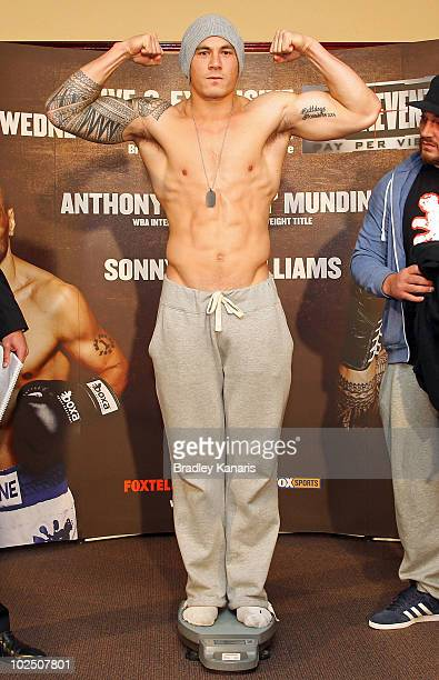 Sonny Bill Williams poses on the scales at the official WeighIn at the Brisbane Entertainment Centre on June 29 2010 in Brisbane Australia Sonny Bill...