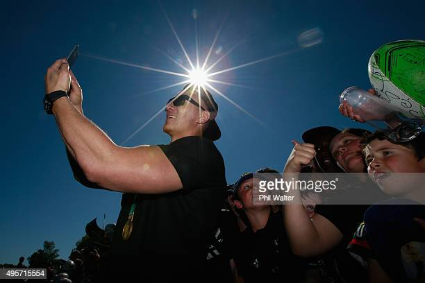 Sonny Bill Williams takes a selfie for a fan during the New Zealand All Blacks welcome home celebrations in Hagley Park on November 5 2015 in...