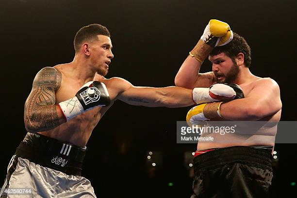 Sonny Bill Williams throws a right at Chauncy Welliver during their heavyweight bout during the Footy Show Fight Night at Allphones Arena on January...