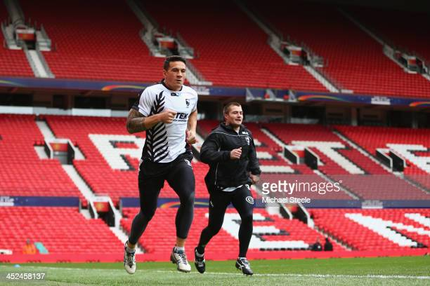 Sonny Boy Williams runs alongside Kieran Foran during the New Zealand training session at Old Trafford on November 29 2013 in Manchester England