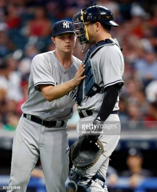 Sonny Gray and Austin Romine the New York Yankees meet between the mound and home plate in the fifth inning at Progressive Field on August 3 2017 in...