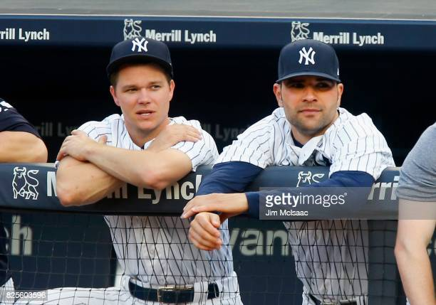 Sonny Gray and Jaime Garcia of the New York Yankees look on during the first inning against the Detroit Tigers at Yankee Stadium on August 1 2017 in...
