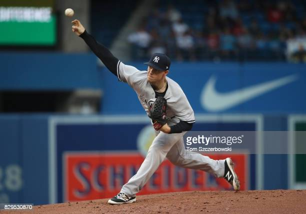 Sonny Gray of the New York Yankees delivers a pitch in the first inning during MLB game action against the Toronto Blue Jays at Rogers Centre on...