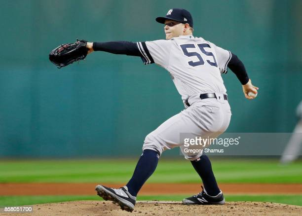 Sonny Gray of the New York Yankees delivers the pitch during the first inning against the Cleveland Indians during game one of the American League...