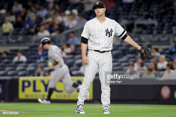 Sonny Gray of the New York Yankees reacts after giving up a solo home run to Corey Dickerson of the Tampa Bay Rays in the first inning at Yankee...