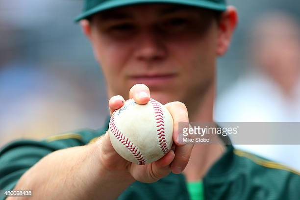 Sonny Gray of the Oakland Athletics handles a baseball prior to th egame against the New York Yankees at Yankee Stadium on July 9 2015 in the Bronx...