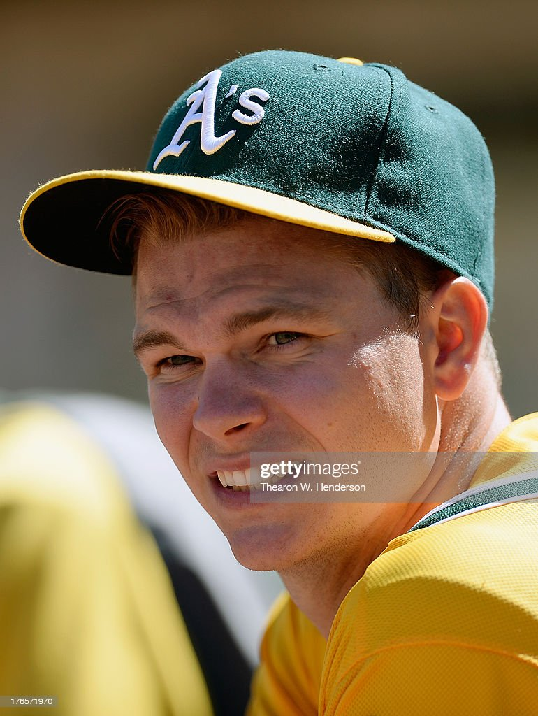 Sonny Gray #54 of the Oakland Athletics looks on from the dugout in the top of the ninth inning against the Houston Astros at O.co Coliseum on August 15, 2013 in Oakland, California. Gray, the A's 2011 first round draft pick, pitched eight shutout innings, with nine strikeouts for his first career win. The A's won 5-0.