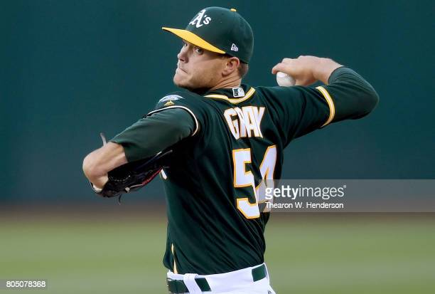 Sonny Gray of the Oakland Athletics pitches against the Atlanta Braves in the top of the first inning at Oakland Alameda Coliseum on June 30 2017 in...