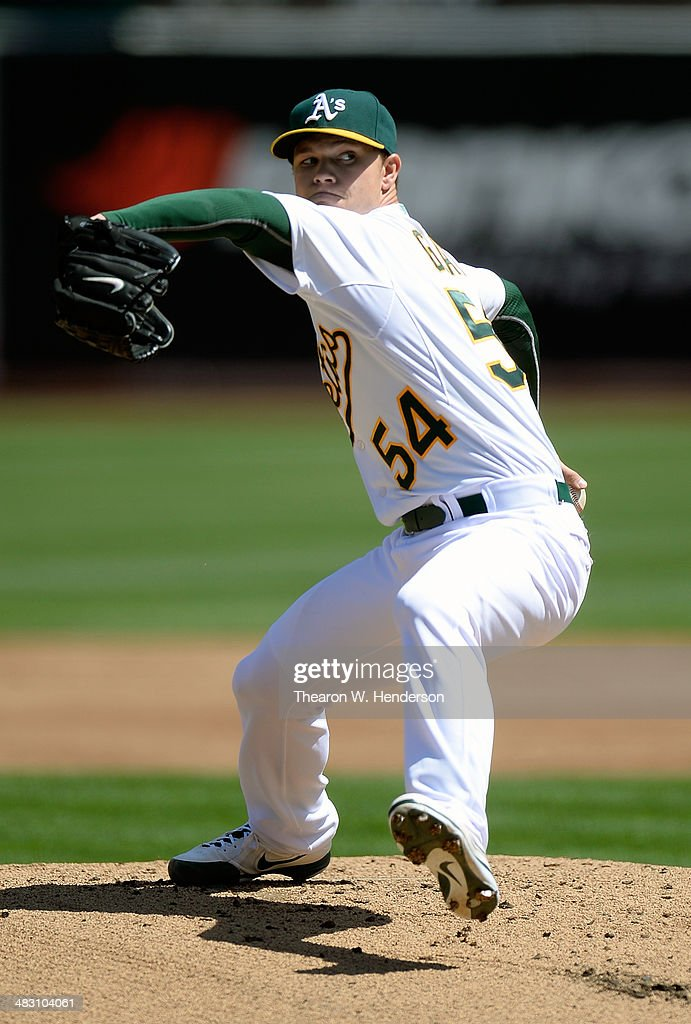 <a gi-track='captionPersonalityLinkClicked' href=/galleries/search?phrase=Sonny+Gray&family=editorial&specificpeople=8046451 ng-click='$event.stopPropagation()'>Sonny Gray</a> #54 of the Oakland Athletics pitches against the Seattle Mariners in the first inning at O.co Coliseum on April 6, 2014 in Oakland, California.